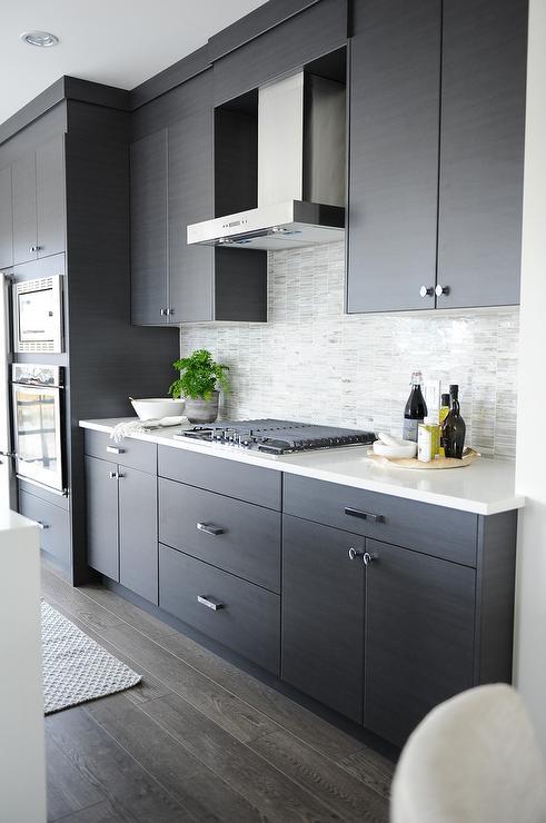 dark-gray-kitchen-cabinets-light-gray-backsplash-tiles.jpg